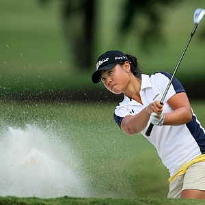 Danielle Kang hits a bunker shot at No. 18. Kang defeated Juliana Murcia Ortiz 1 up.