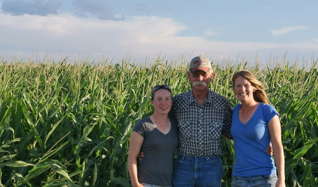 "(Left to right) Anna Christenson, ""the farmer"" and Alison Whitaker in Nebraska."