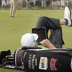 Charley Hoffman relaxes at the putting green during a fog delay before the first round of the PGA Championship.