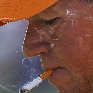 John Daly smokes a cigarette on the 10th hole during the first round of the PGA Championship.
