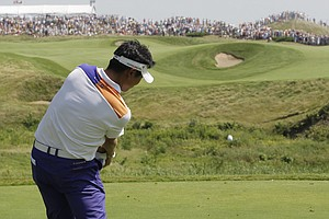 Defending champion Y.E.Yang hits a drive on the 10th hole during the first round of the PGA Championship.