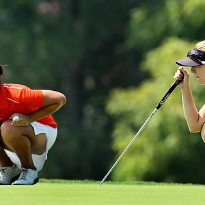 Danielle Kang and Sydnee Michaels line up their putts.