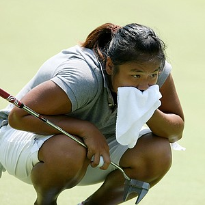 Junthima (Numa) Gulyanamitta looks over her line at No. 13. Gulyanamitta lost to Stephanie Sherlock.