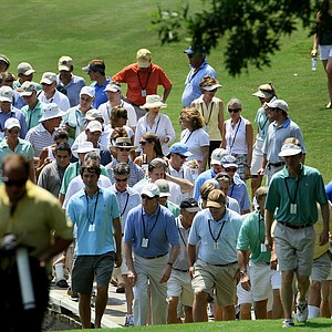 A small crowd crosses one of the bridges during Friday's quarterfinals of the  2010 Women's Amateur.