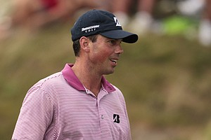 Matt Kuchar tosses a ball after making a birdie on the 11th hole during the second round of the PGA Championship.