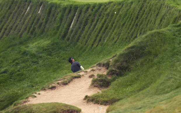 Mike Weir hits out of some rough on the 17th hole during the first round of the PGA Championship.