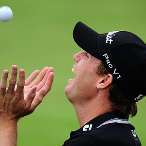 Nick Watney reaches for his golf ball during the continuation of the first round of the 92nd PGA Championship.