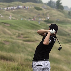 Nick Watney hits his tee shot on the 13th hole at Whistling Straits.