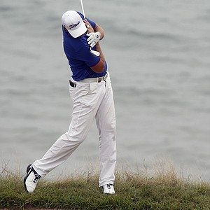 Robert Karlsson stretches before hitting out of a bunker on the fourth hole during the first round of the PGA Championship.