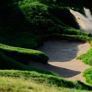 Raphael Jacquelin hits from a bunker on the 18th hole during the first round of the 92nd PGA Championship.