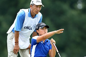 Danielle Kang with her father/caddie, K.S. Kang read their putt at No. 18. Kang defeated Jennifer Kirby at No. 18 by staying 1 up.