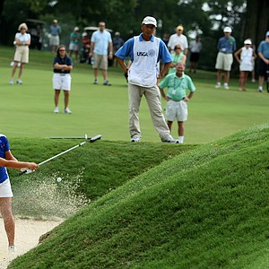 Danielle Kang hits out of a greenside bunker at No. 2.