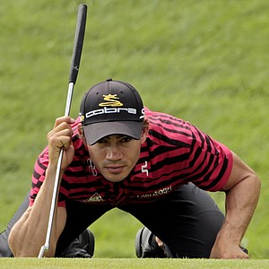 Camilo Villegas lines up a putt on the 18th hole during the second round of the PGA Championship.