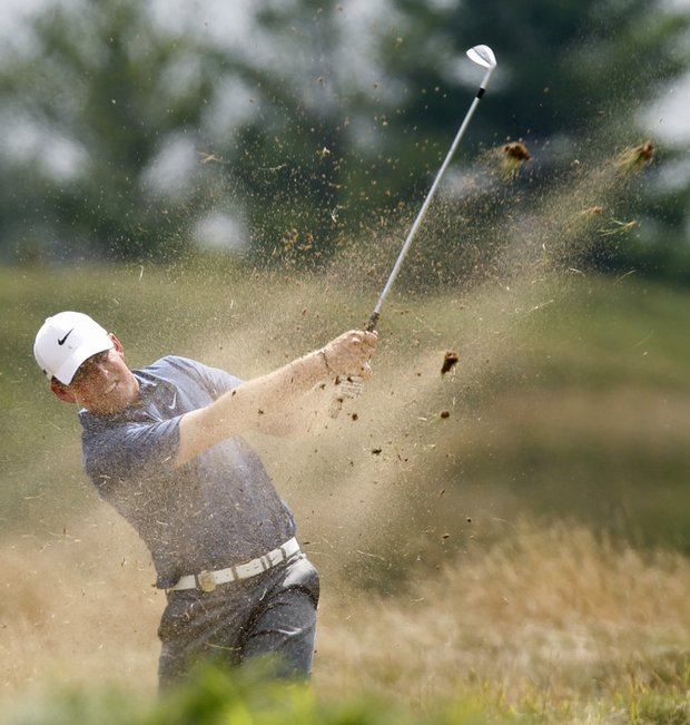Justin Leonard hits out of a bunker on the fifth hole during the third round of the PGA Championship.