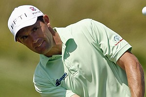 Padraig Harrington of Ireland chips up to the 16th green during the first round of the PGA Championship.