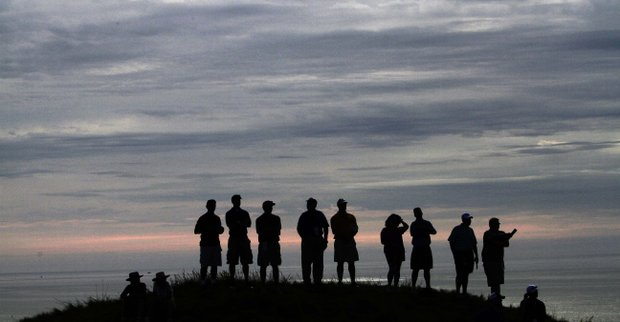 Fans line a hill on the 12th fairway to see Tiger Woods during the second round of the PGA Championship.