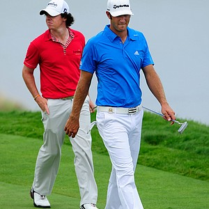 Rory McIlory and Dustin Johnson walk the fourth hole during the third round of the 92nd PGA Championship.