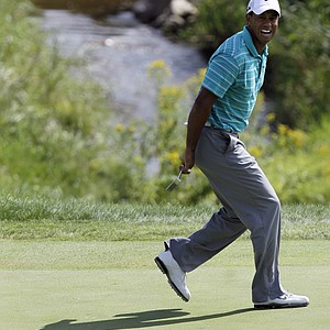 Tiger Woods reacts after missing a birdie putt on the 18th hole during the second round of the PGA Championship.