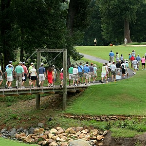 Spectators cross a suspension bridge at No. 12 during Sunday's finals.