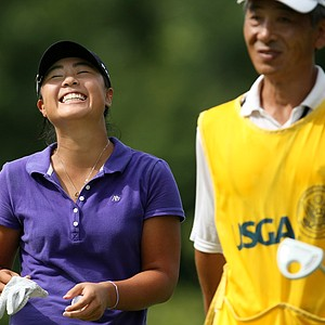 Danielle Kang shares a laugh with her father/caddie, K.S. Kang after making birdie at No. 8 during the first 18 holes of Sunday's finals.
