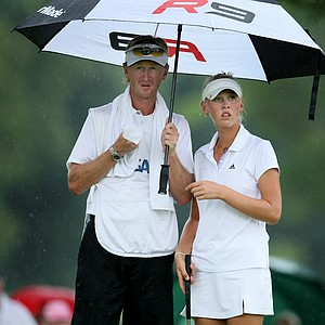 Jessica Korda with her father/caddie, Petr Korda, as the rain started falling at No. 8, her 26th hole of the day.