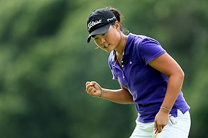 Danielle Kang pumps her fist after making birdie at No. 14, her 32nd hole.