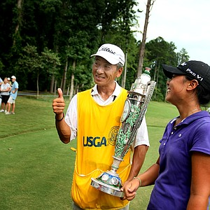 Danielle Kang's father/caddie K.S. Kang gives a thumbs up after Danielle gave him the Robert Cox Trophy after winning the 2010 Women's Amateur.