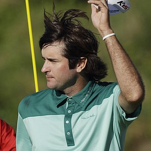 Bubba Watson tips his cap after putting out on the 18th hole during the final round of the PGA Championship.