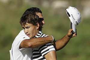 Camilo Villegas hugs his caddie Bret Waldman on the 18th hole after finishing his final round of the PGA Championship.
