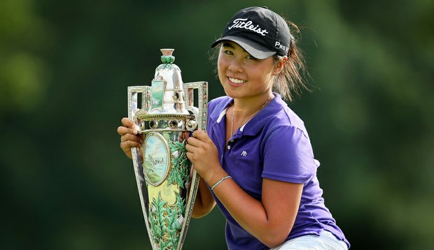 Danielle Kang poses with the Robert Cox Trophy after winning the U.S. Women's Amateur on Aug. 15.