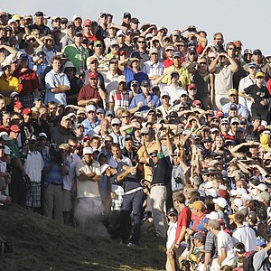 Dustin Johnson hits from the crowd on the 18th hole during the final round of the PGA Championship.