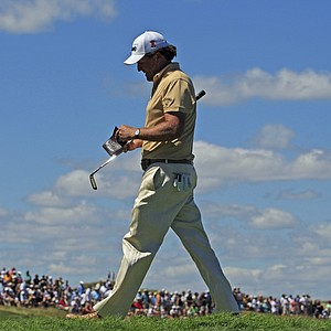 Phil Mickelson walks off the 16th green during the final round of the PGA Championship.