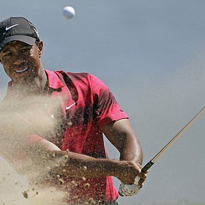Tiger Woods hits out of a bunker on the 12th hole during the final round of the PGA Championship.