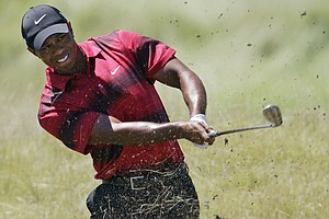 Tiger Woods hits out of the rough on the 10th hole during the final round of the PGA Championship.