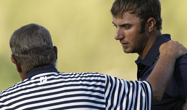 Dustin Johnson talks with rules official David Price on the 18th hole during the final round of the PGA Championship.