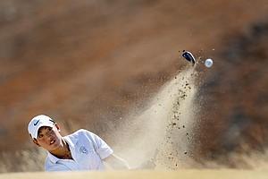 Brian Hwang hits out of a bunker at No. 9.