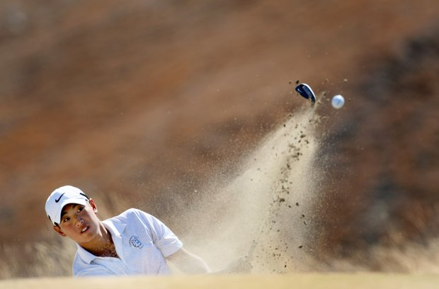 Brian Hwang hits out of a bunker at No. 9.