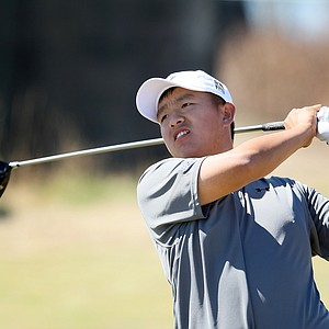 Eugene Wong watches his tee shot at No. 18 during the 110th U.S. Amateur Championship.