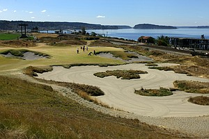 The par-3 17th runs along the Pugent Sound at Chambers Bay.