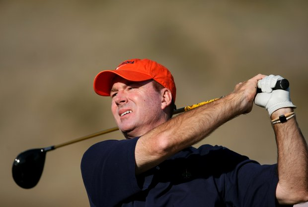 Bowen Sargent, University of Virginia head coach, watches his tee shot at No. 1.