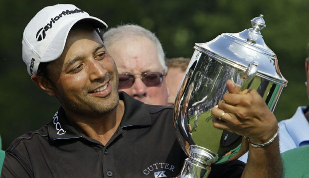 Arjun Atwal holds the Sam Snead Cup on the 18th green after winning the Wyndham Championship.