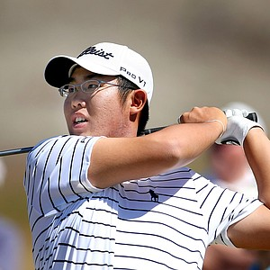 Defending champion Byeong-Hun An hits a shot at Chambers Bay.