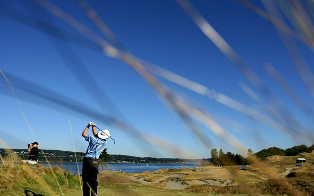 Daniel Bowden holds his follow-through after teeing off at Chambers Bay's third hole.