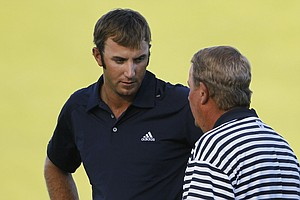 Dustin Johnson speaks with a rules official on the 18th green during the final round of the PGA Championship.