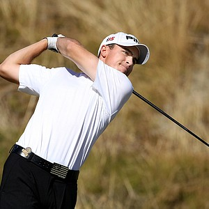 Scott Langley watches his tee shot at Chambers Bay's seventh hole.