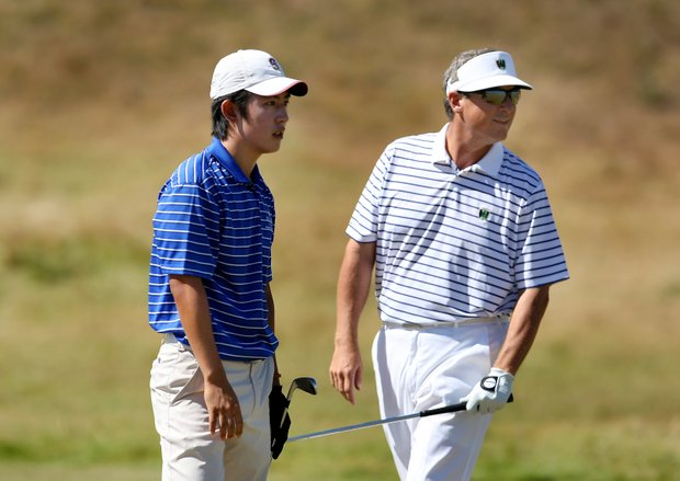 David Chung, left, watches his second shot at No. 11 with Mike McCoy, during the Round of 64. Chung defeated McCoy 3 & 2.