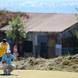 Champions Tour player Bob Tway helps his son Kevin Tway line up a putt at No. 17 during the Round of 64. Tway lost Blayne Barber.