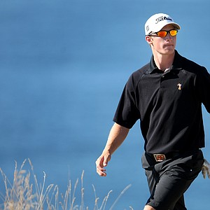 Morgan Hoffmann walks to the 15th green during the Round of 64. Hoffamann won 2 up over Albin Choi.