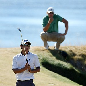 Peter Uihlein watches as Cheng Tsung Pan misses his putt at No. 15. Uihlein advances to Round of 16 on Thursday.