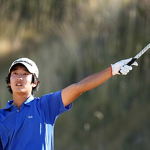 Alex Shi Yup Kim urges his ball to go left during the second round of stroke-play qualifying at the U.S. Amateur.